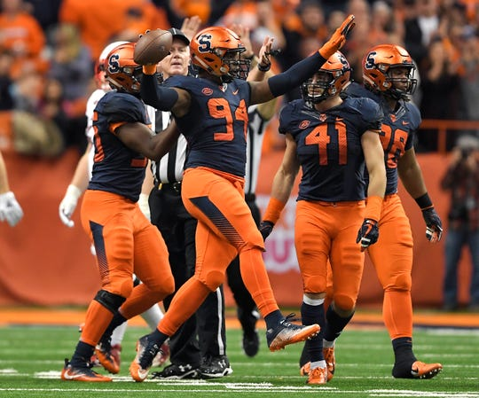 Syracuse defensive lineman Alton Robinson (94) celebrates a defensive fumble recovery during the first half of an NCAA college football game against Louisville in Syracuse on Friday, Nov. 9, 2018.