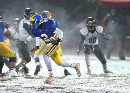Cleveland Hill quarterback Javon Thomas goes around the end.