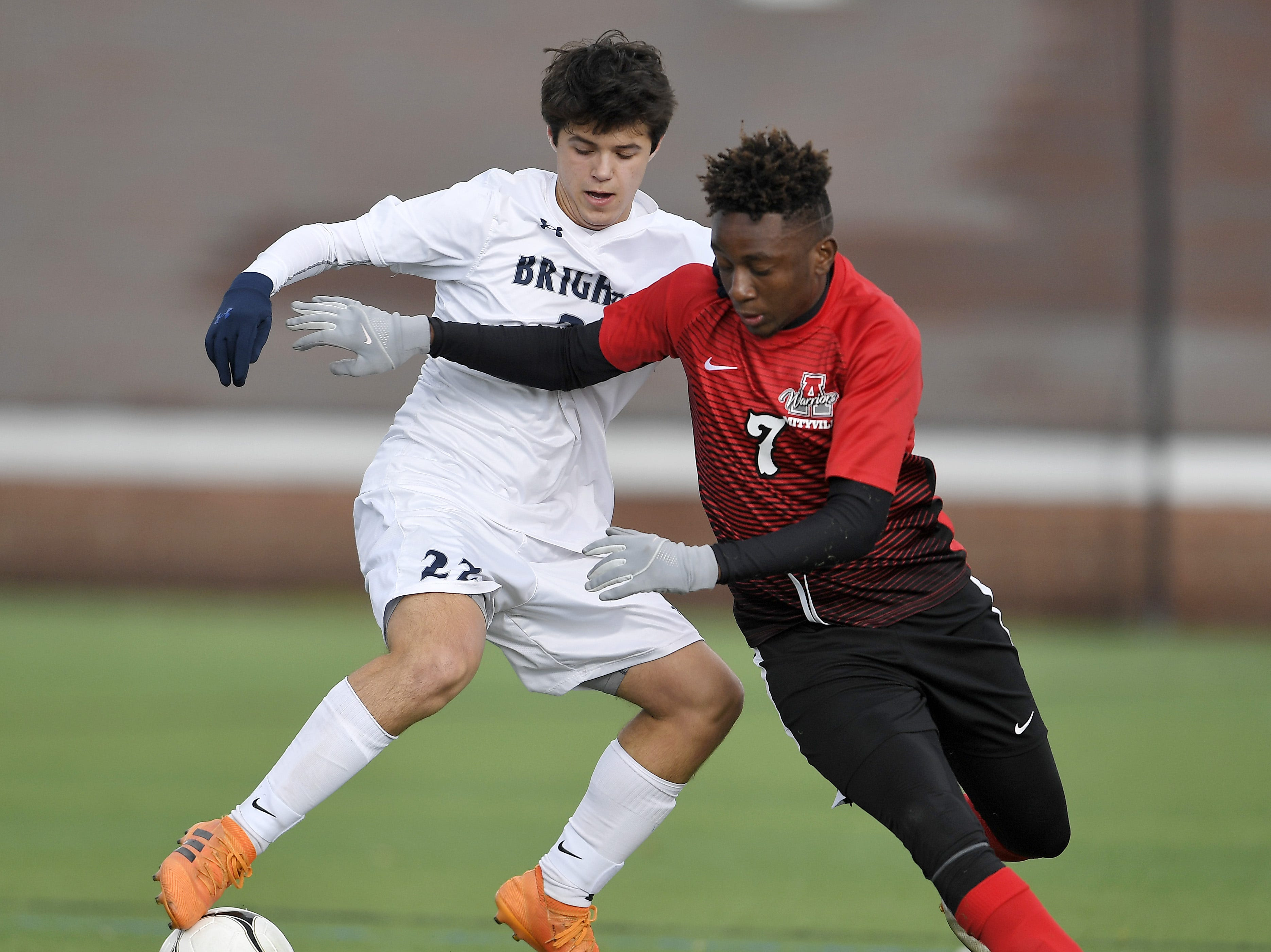 Brighton's Nico Leone, left, is defended by Amityville's Kymani Hines during a Class A semifinal at the NYSPHSAA Boys Soccer Championships in Newburgh, N.Y., Saturday, Nov. 10, 2018.