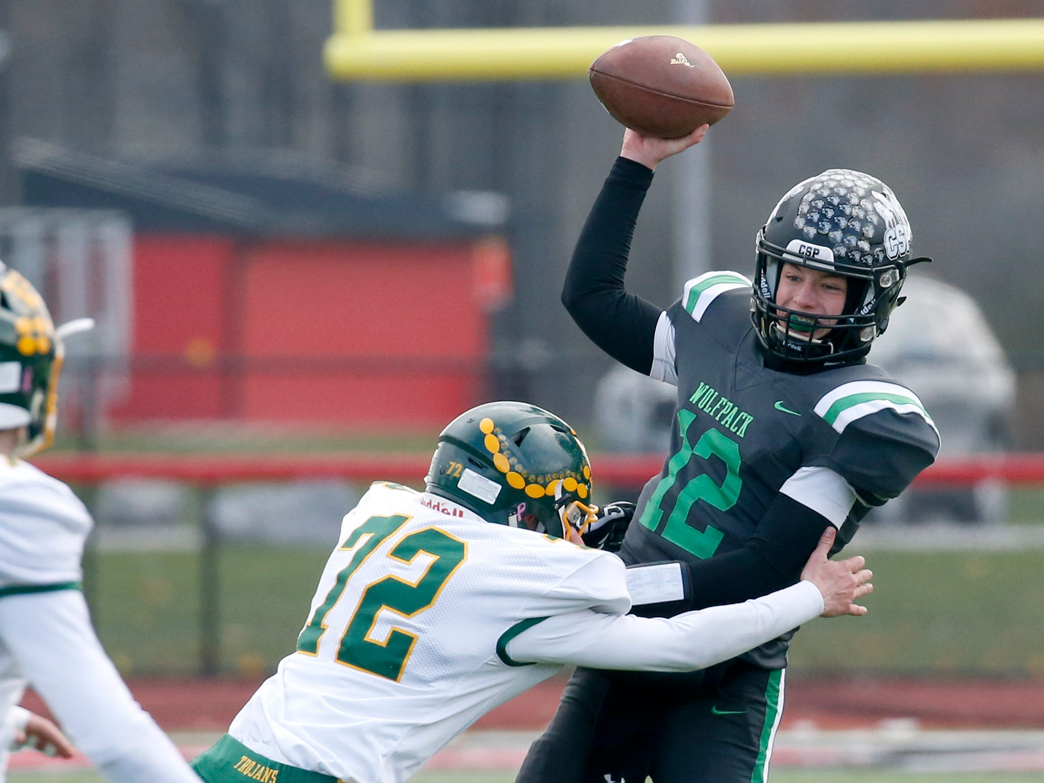 Alexander's Joshua Kelsey tackles Clymer-Sherman-Panama's Gerrit Hinsdale before he can throw in the first quarter at Clarence High School.