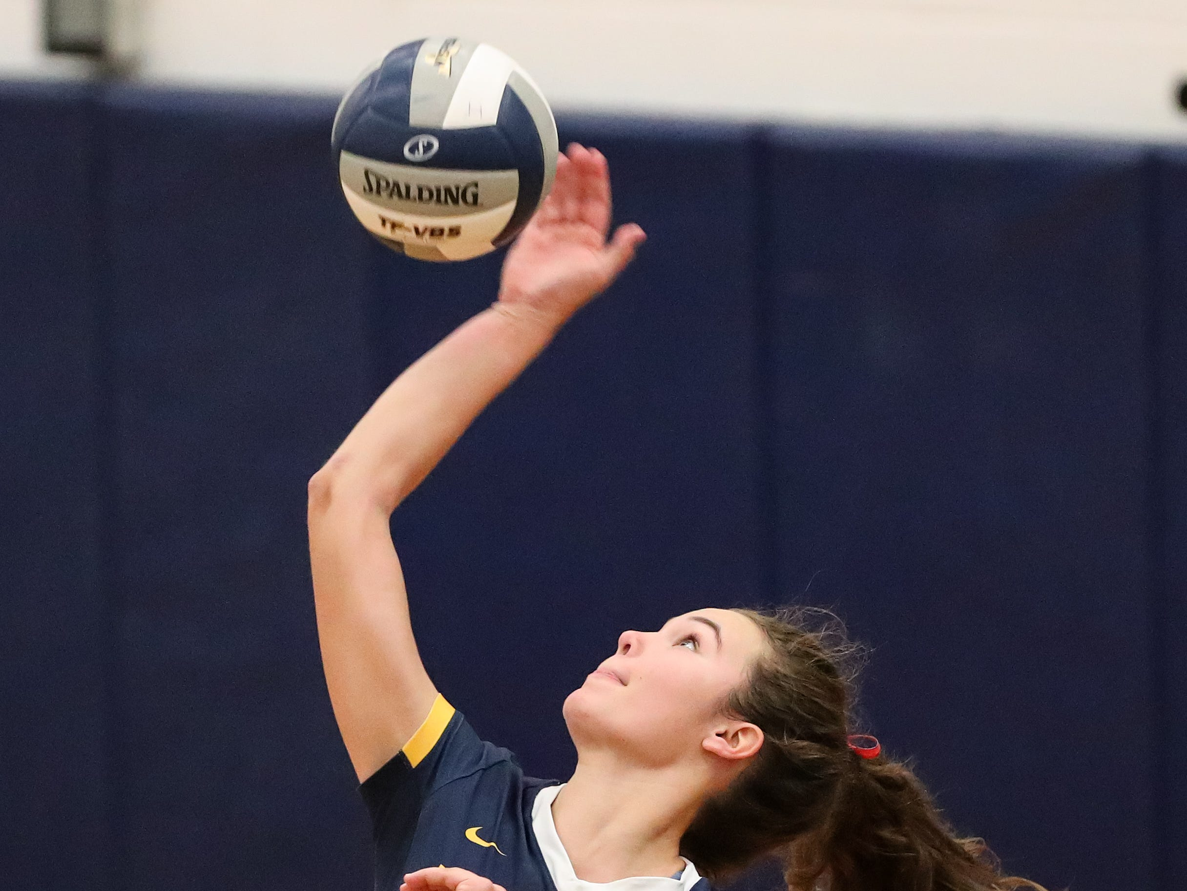 Victor's Emma Werkmeister (12) serves the ball against the Orchard Park Quakers during a NYSPHSAA Class AA West Regional high school girls volleyball match at Webster Thomas on Nov. 9, 2018.