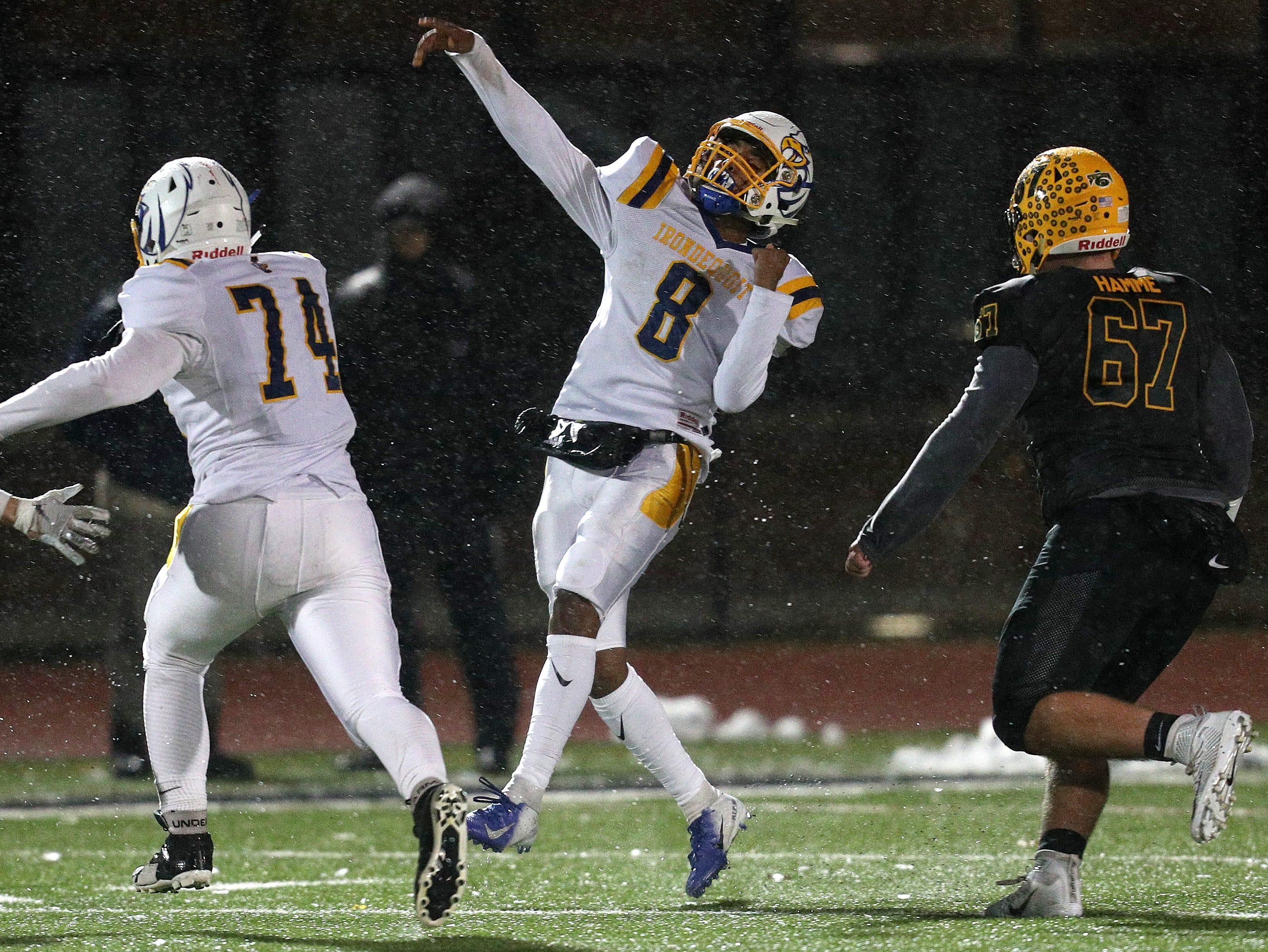 Irondequoit quarterback Freddy June Jr. throws deep against West Seneca East.