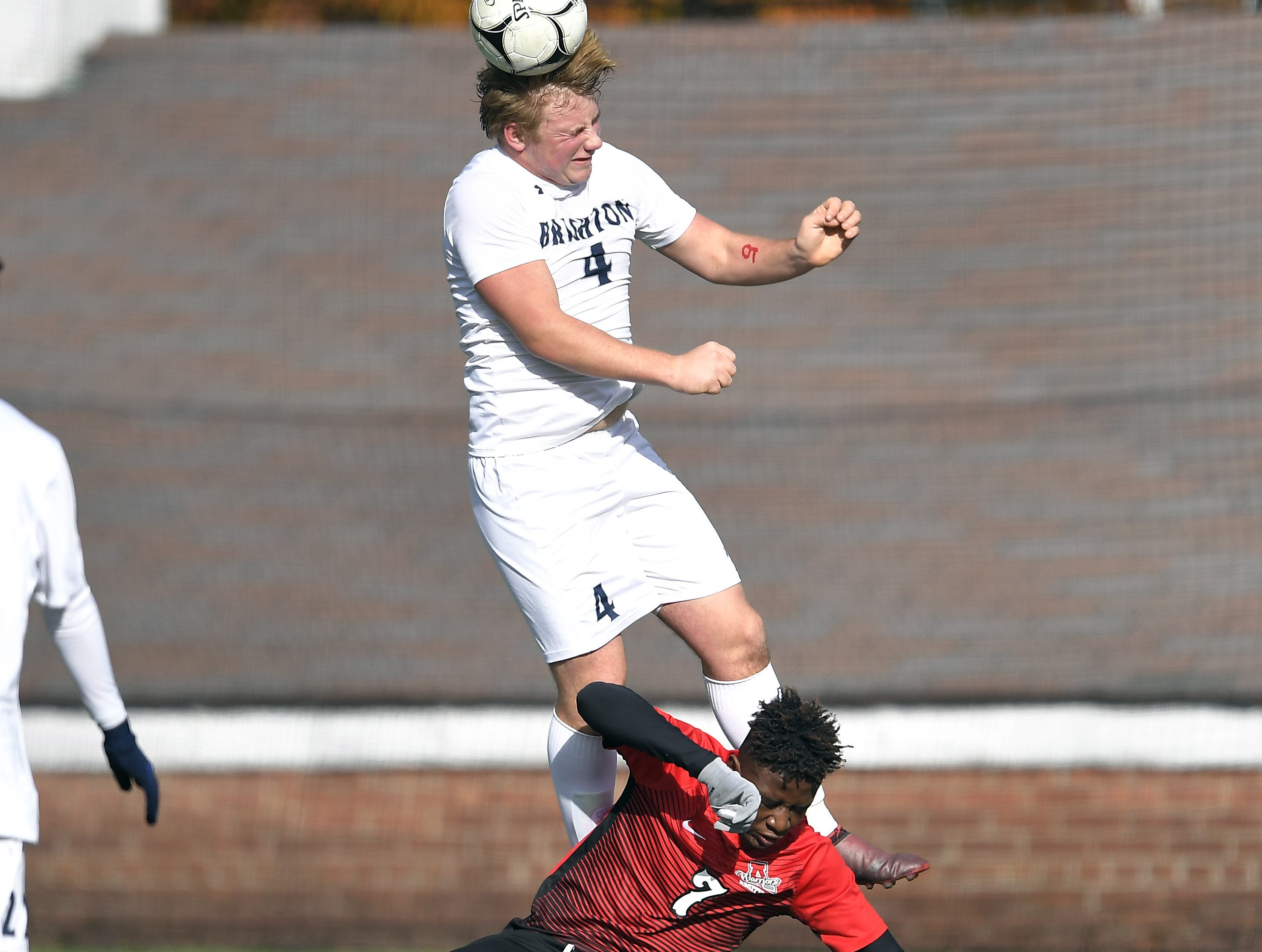 Brighton's Lyosha Georas, top, wins a header over Amityville's Kymani Hines during a Class A semifinal at the NYSPHSAA Boys Soccer Championships in Newburgh, N.Y., Saturday, Nov. 10, 2018.