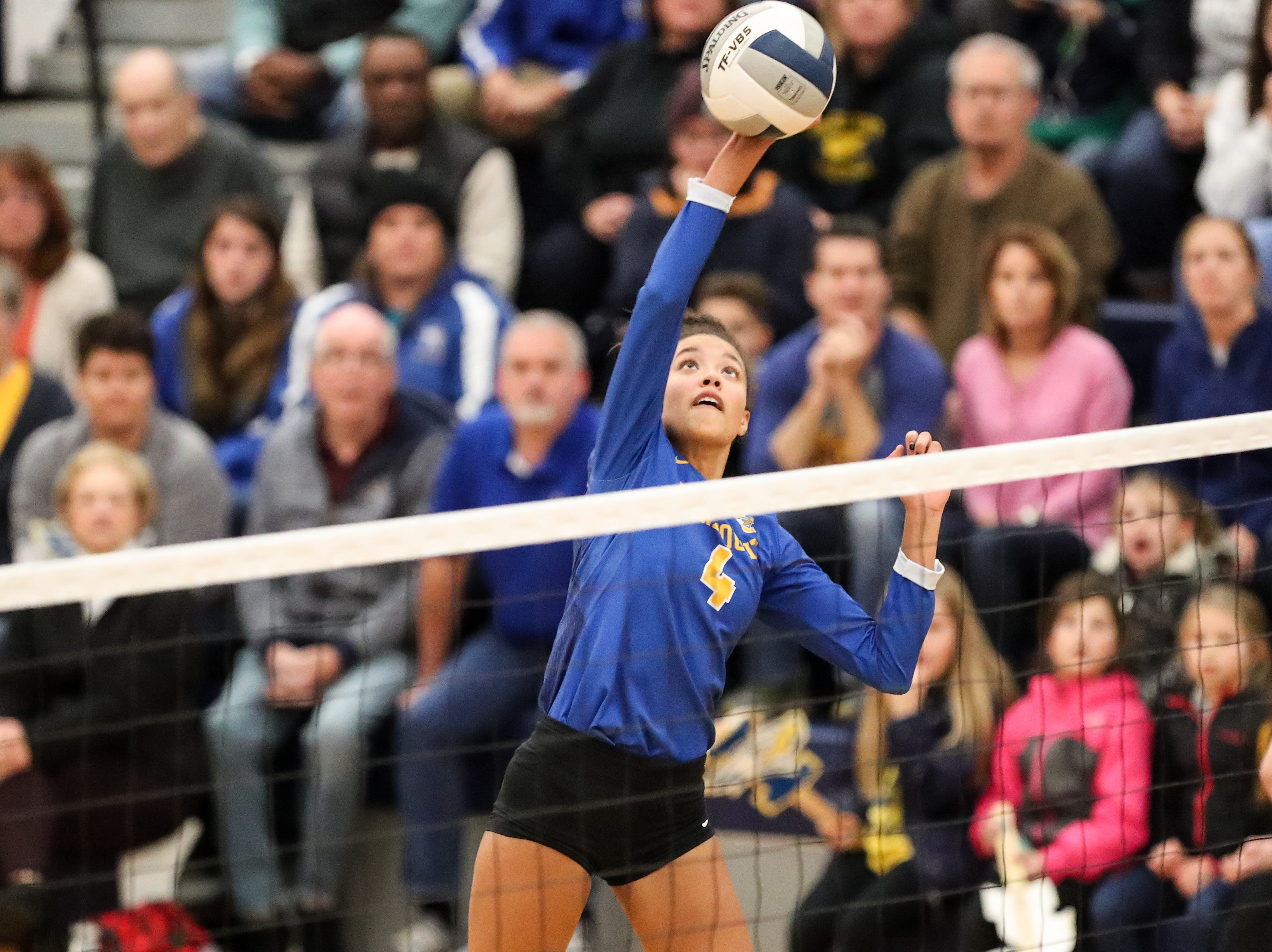 November 9, 2018; Webster, NY; USA; Irondequoit Eagles outside hitter Drew Kemp (4) spikes the ball against the Niagara-Wheatfield Falcons during a NYSPHSAA Class A West Regional high school girls volleyball match at Webster Thomas H.S..  Photo: Christopher Cecere