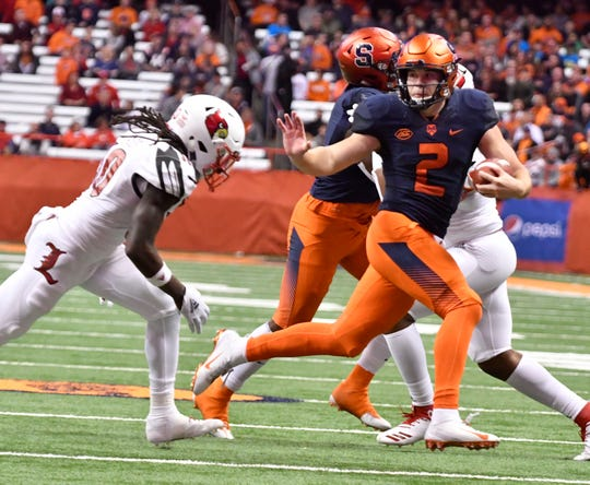 Nov 9, 2018; Syracuse, NY, USA; Syracuse Orange quarterback Eric Dungey (2) runs with the football against Louisville Cardinals safety Khane Pass (30) during the second quarter at the Carrier Dome. Mandatory Credit: Mark Konezny-USA TODAY Sports