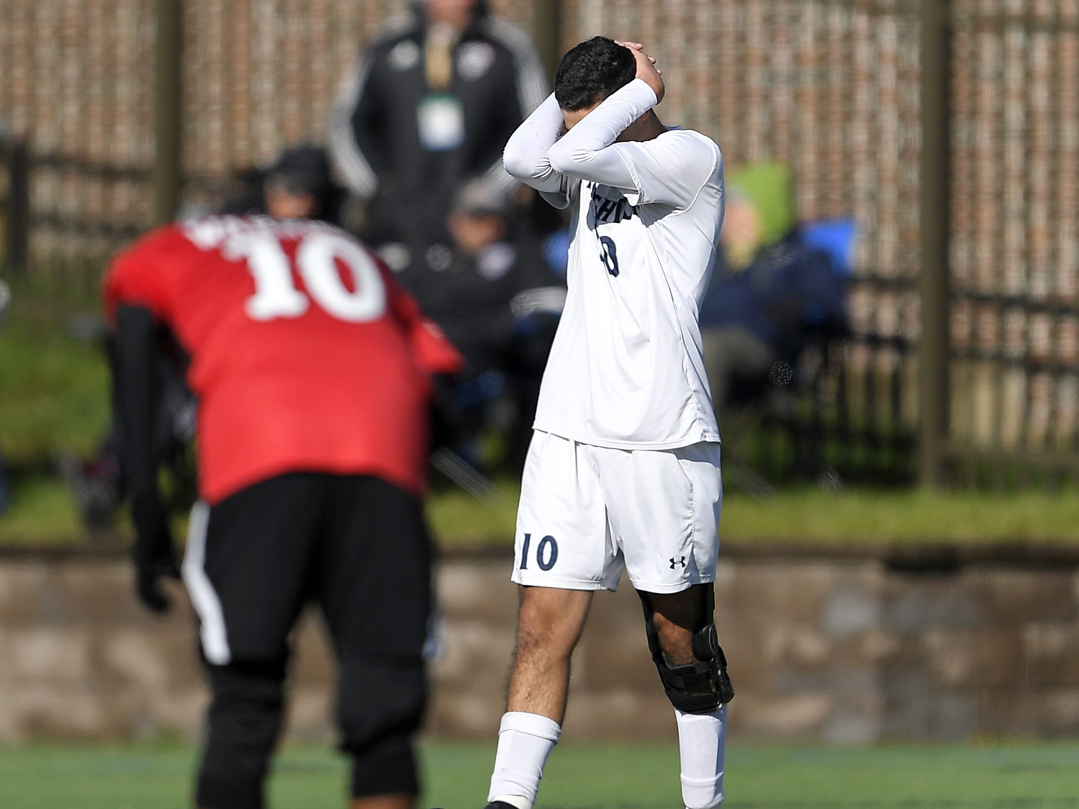 Brighton's Caio De Medeiros reacts after nearly missing a shot on goal during a Class A semifinal at the NYSPHSAA Boys Soccer Championships in Newburgh, N.Y., Saturday, Nov. 10, 2018. Brighton's season ended with a 2-0 loss to Amityville-XI.