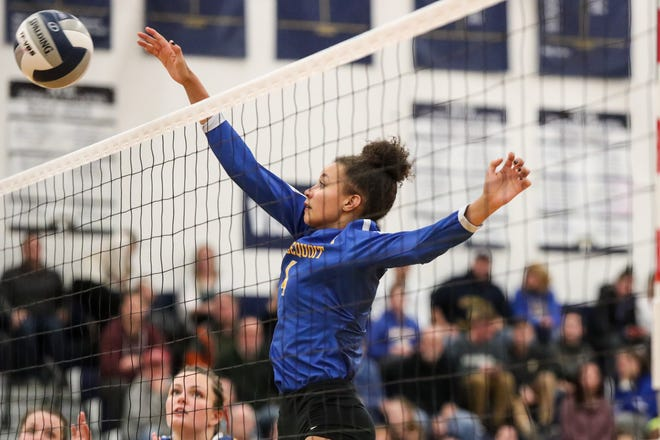 Irondequoit Eagles Drew Kemp (4) spikes the ball against the Niagara-Wheatfield Falcons during a NYSPHSAA Class A West Regional high school girls volleyball match at Webster Thomas on Nov. 9, 2018.