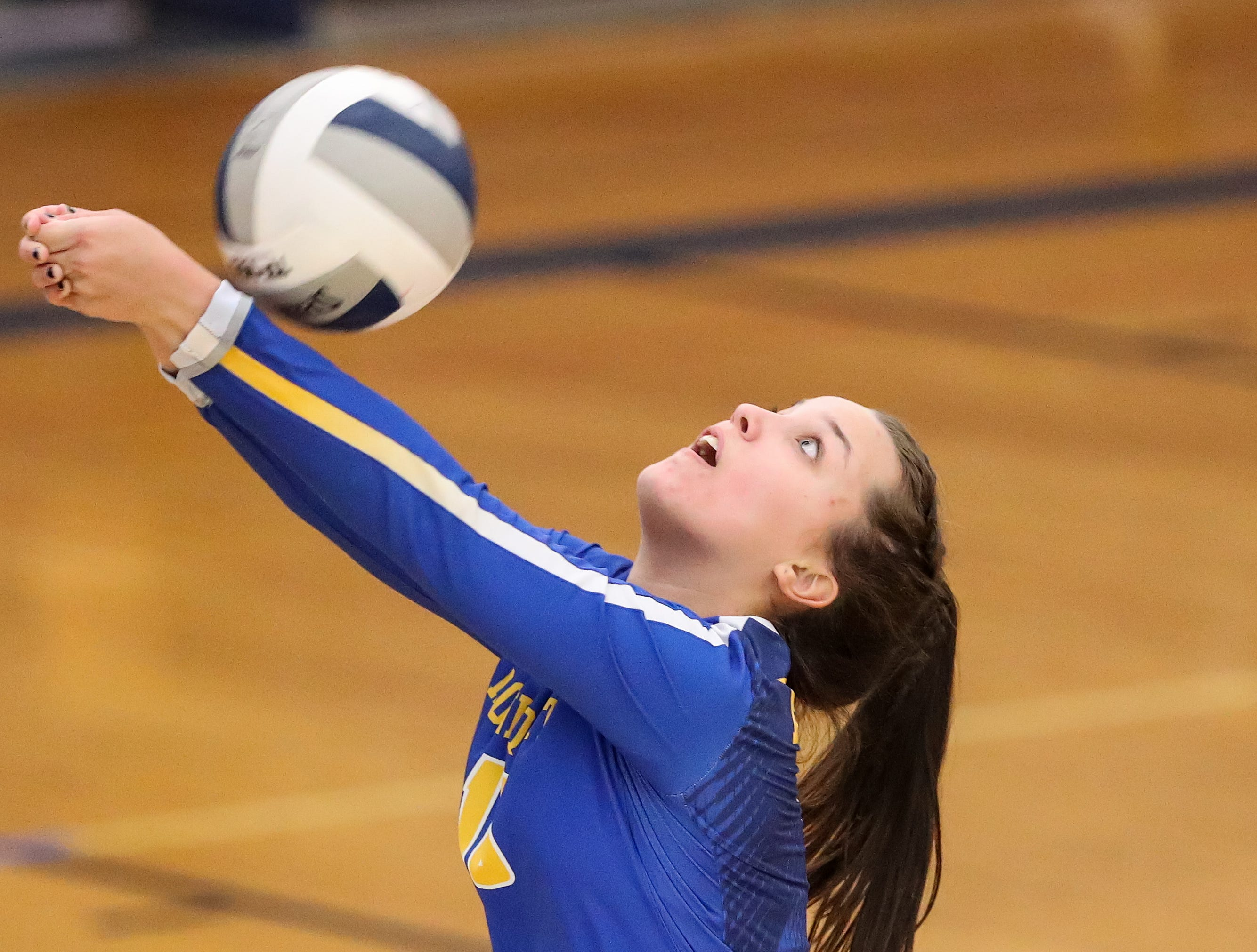 Irondequoit Eagles setter Emma Sheehan (10) saves the ball from going out against the Niagara-Wheatfield Falcons during a NYSPHSAA Class A West Regional high school girls volleyball match at Webster Thomas on Nov. 9, 2018.