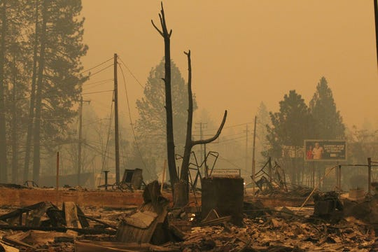 The Northern California town of Paradise was a burned ghost town on Friday, Nov. 9, 2018, a day after the Camp Fire swept through. Most of the businesses on the Skyway were destroyed. Some schools were burned out. People escaping the fire abandoned their cars on the road.