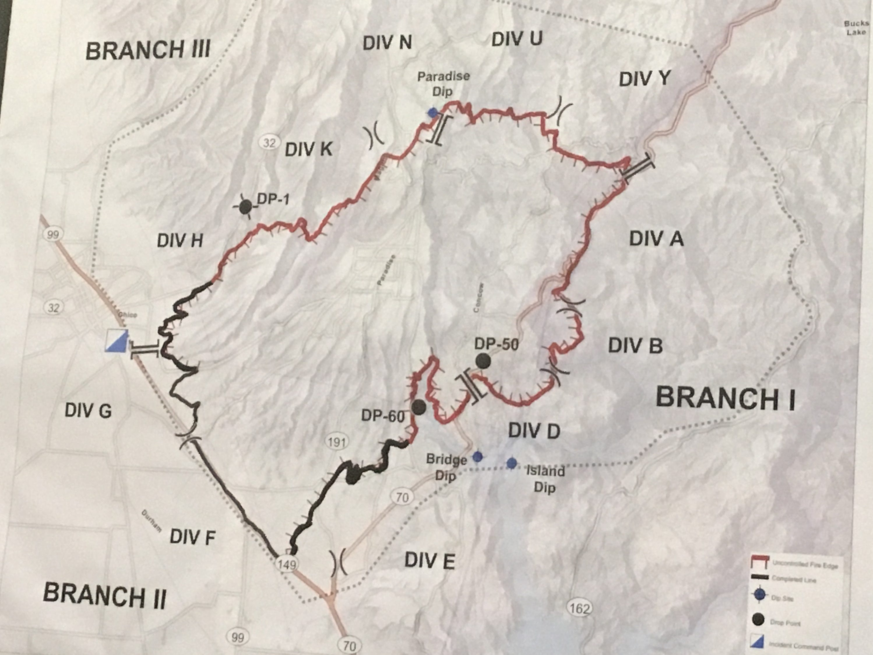 A map shows the Camp Fire boundary as of Saturday morning, posted at the incident command center at the Silver Dollar Fair grounds in Chico.