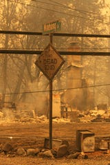 The Northern California town of Paradise was burned ghost town on Friday, Nov. 9, 2018, a day after the Camp Fire swept through. Most of the businesses on the Skyway were destroyed. Some schools were burned out. People escaping the fire abandoned their cars. (Hung T. Vu/Special to the Record Searchlight)
