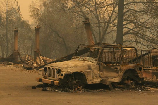 The Northern California town of Paradise was a burned ghost town on Friday, Nov. 9, 2018, a day after the Camp Fire swept through. Most of the businesses on the Skyway were destroyed. Some schools were burned out. People escaping the fire abandoned their cars on the road. This Jeep burned up in the Edward Jones parking lot. (Hung T. Vu/Special to the Record Searchlight)