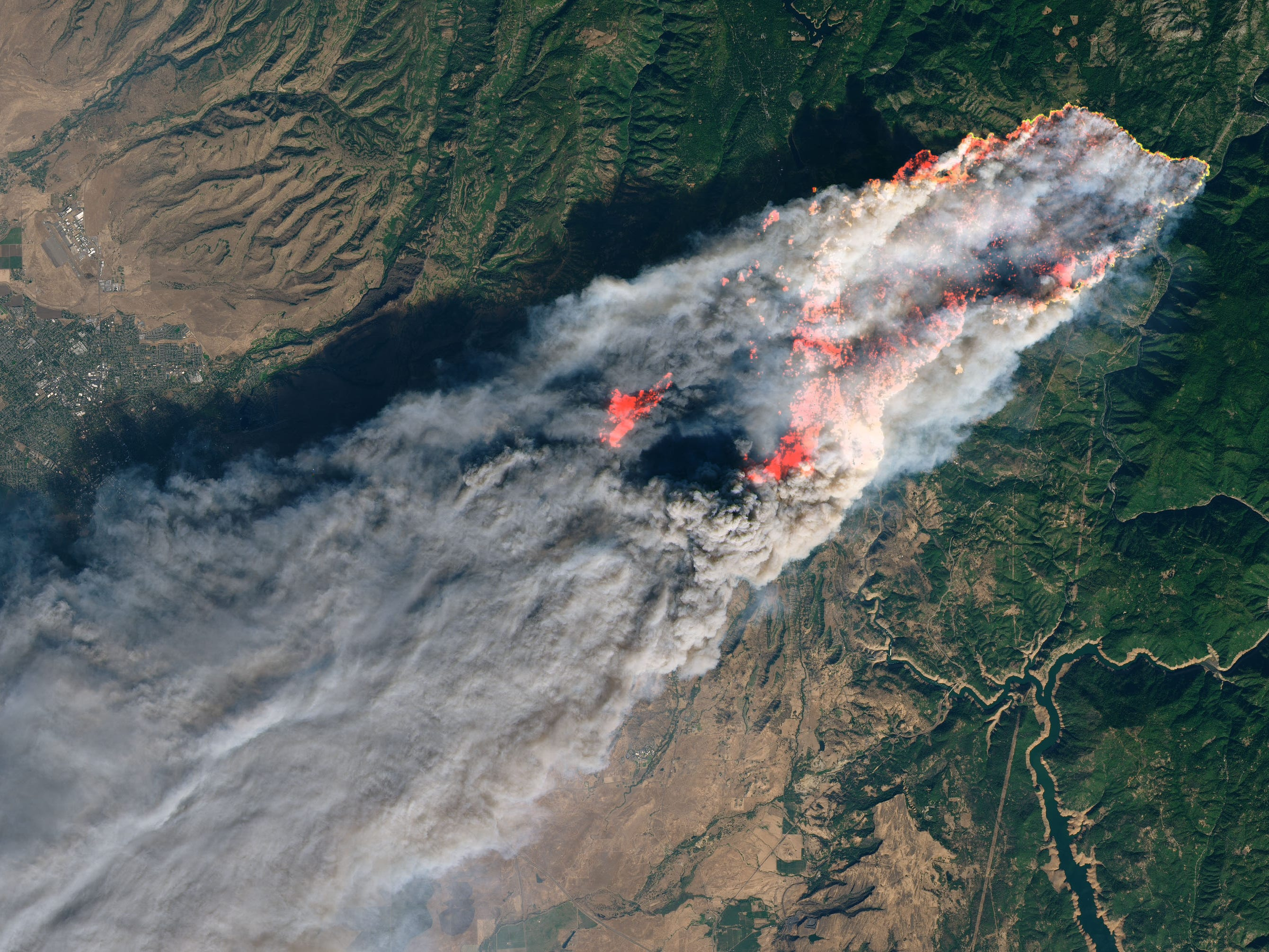 An image from a NASA earth satellite from 10:45 a.m. Thursday shows the extent of the Camp Fire. The photo uses shortwave-infrared light to highlight the active fire.