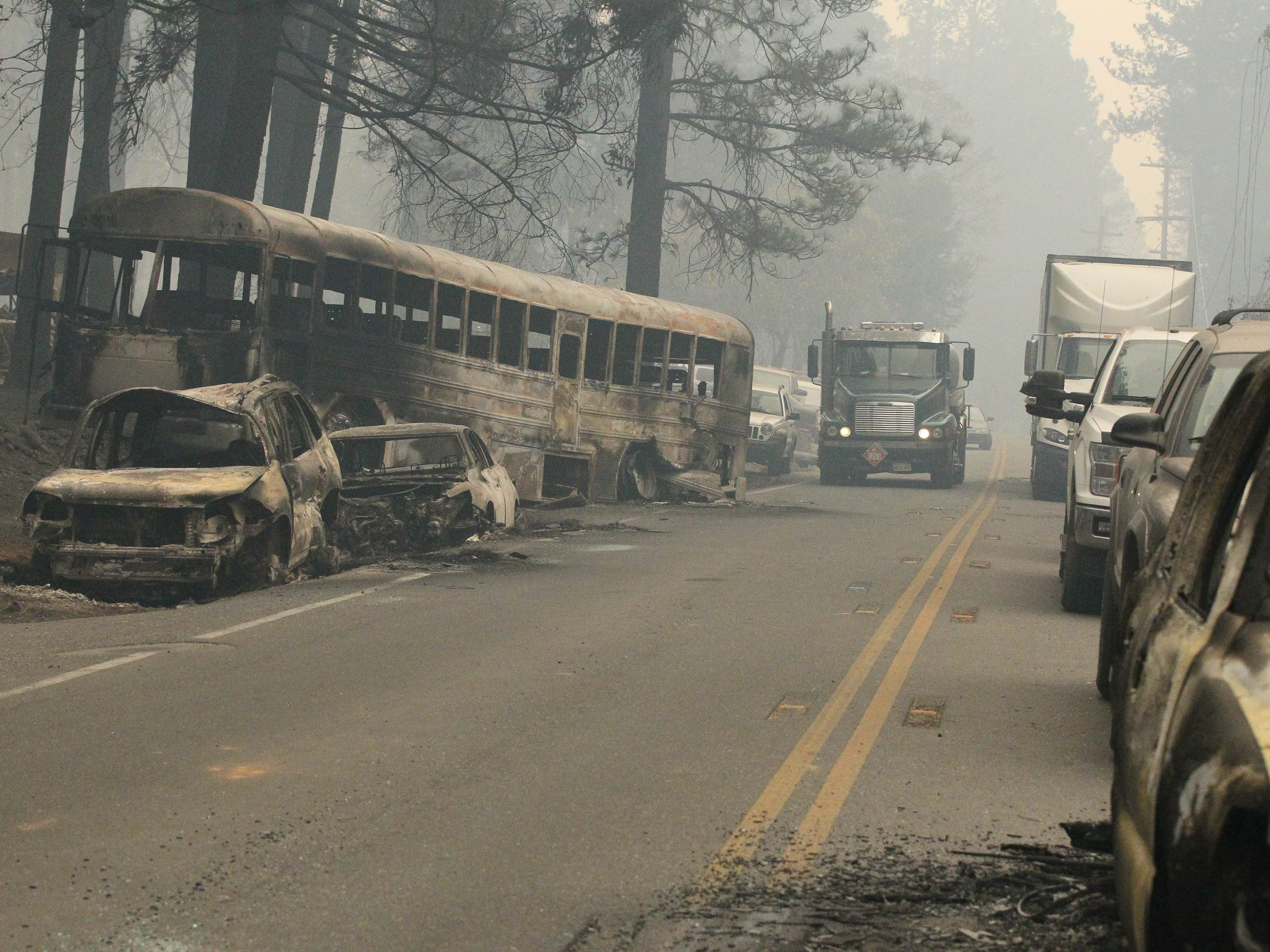 Burned-out vehicles litter roads leading into Paradise in the aftermath of the Camp Fire.