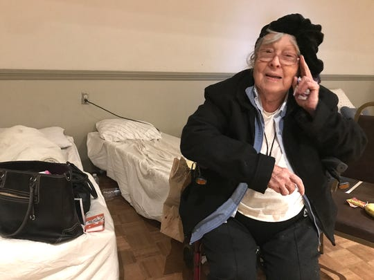 Lucille Salyers rests at the Chico Elks Lodge on Friday, Nov. 9, 2018 where she is staying after being rescued by Oroville police from her Magalia home during the Camp Fire.