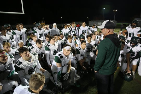West Salem head coach Shawn Stanley talks to his team after a 24-14 loss against Clackamas High School during the second round of the 6A playoffs in Clackamas on Friday, Nov. 9, 2018.