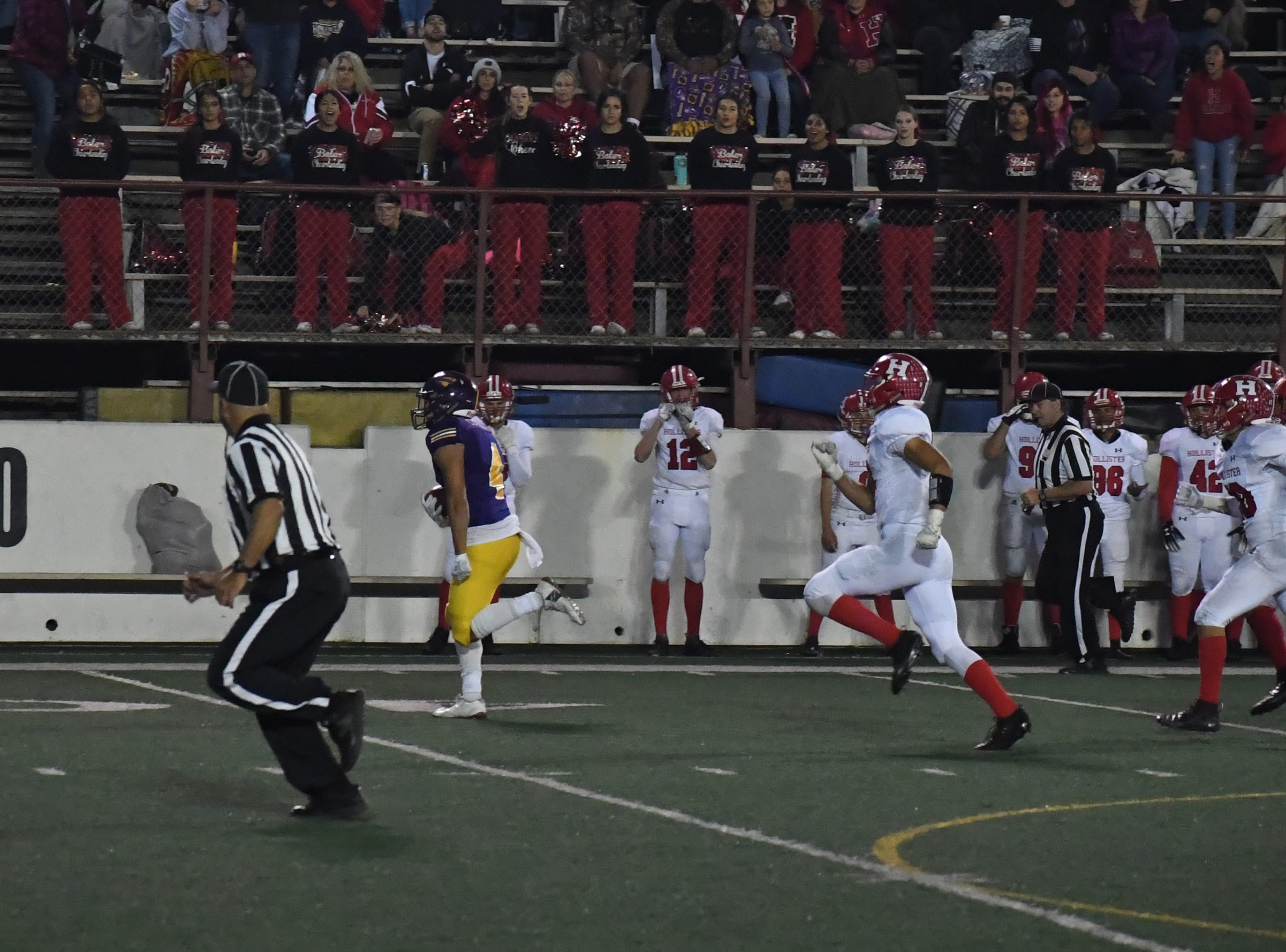 Wide receiver Ivan Curiel (4) sprints to the end zone after recovering a fumble.
