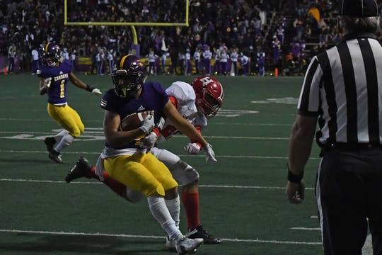 Wide receiver Ivan Curiel (4) spins away from a San Benito defender.