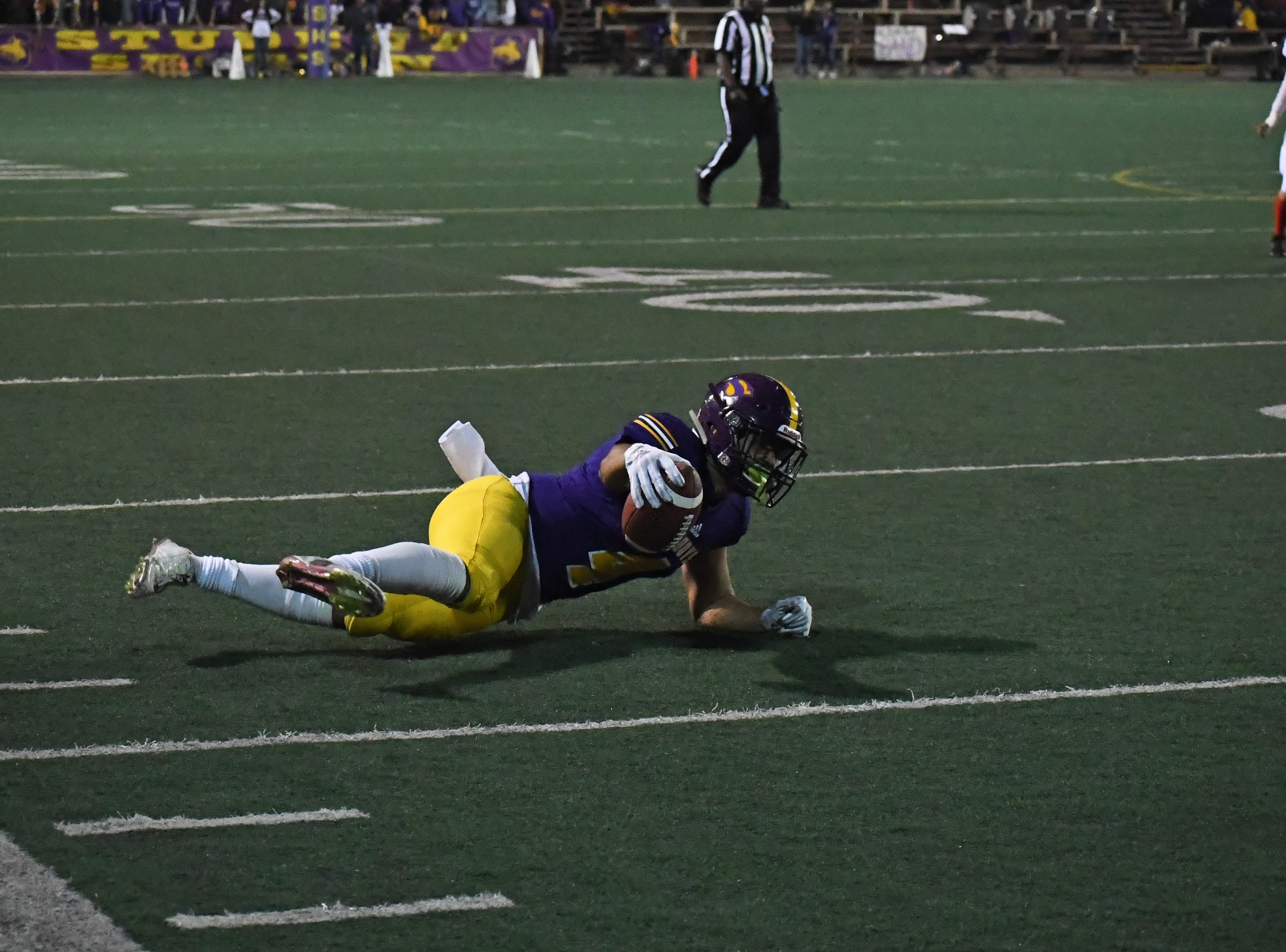 Wide receiver Ivan Curiel (4) extends the ball past the first-down yard marker.