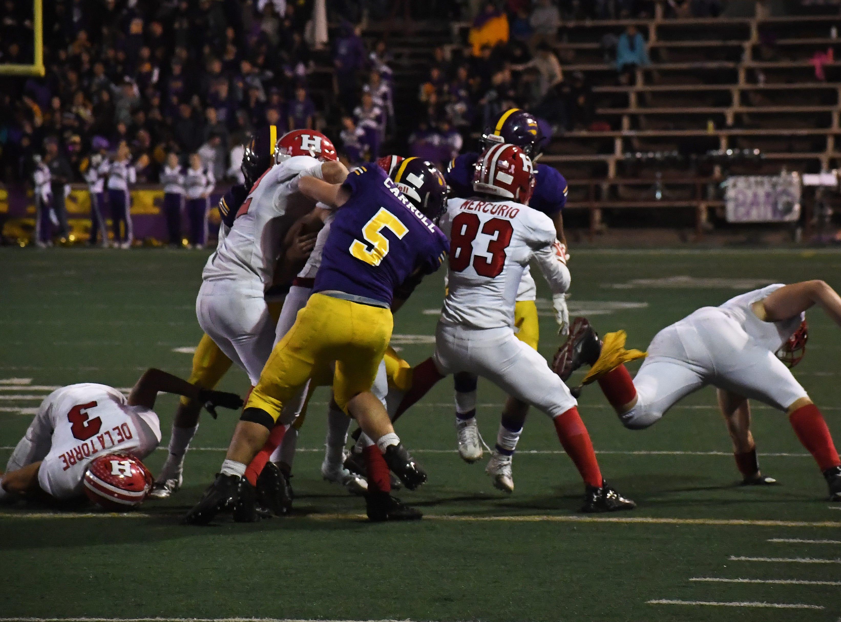Linebacker Tyler Carroll (5) corrals a San Benito running back.