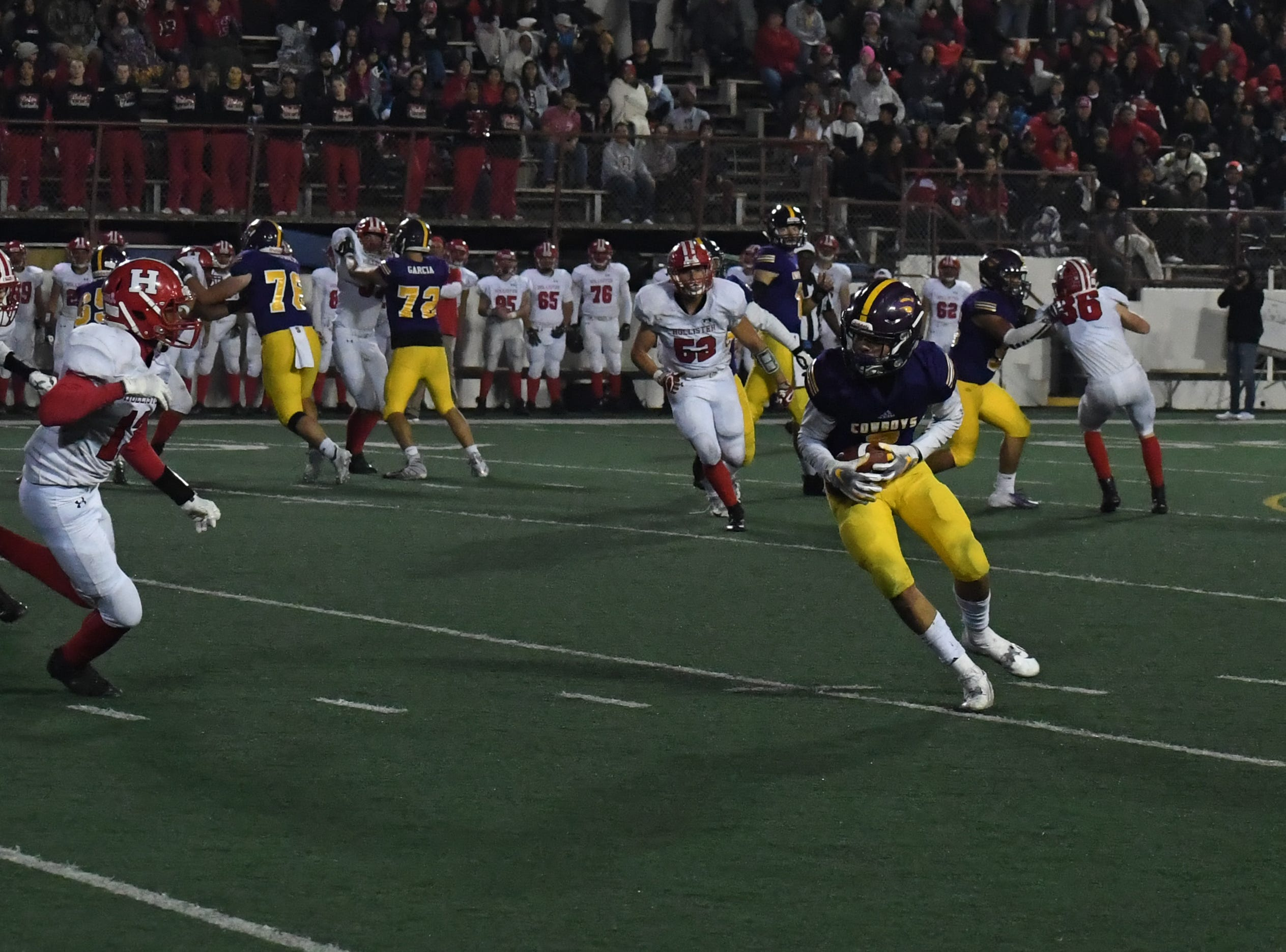Wide receiver Zachary Robison (2) turns upfield following a catch.