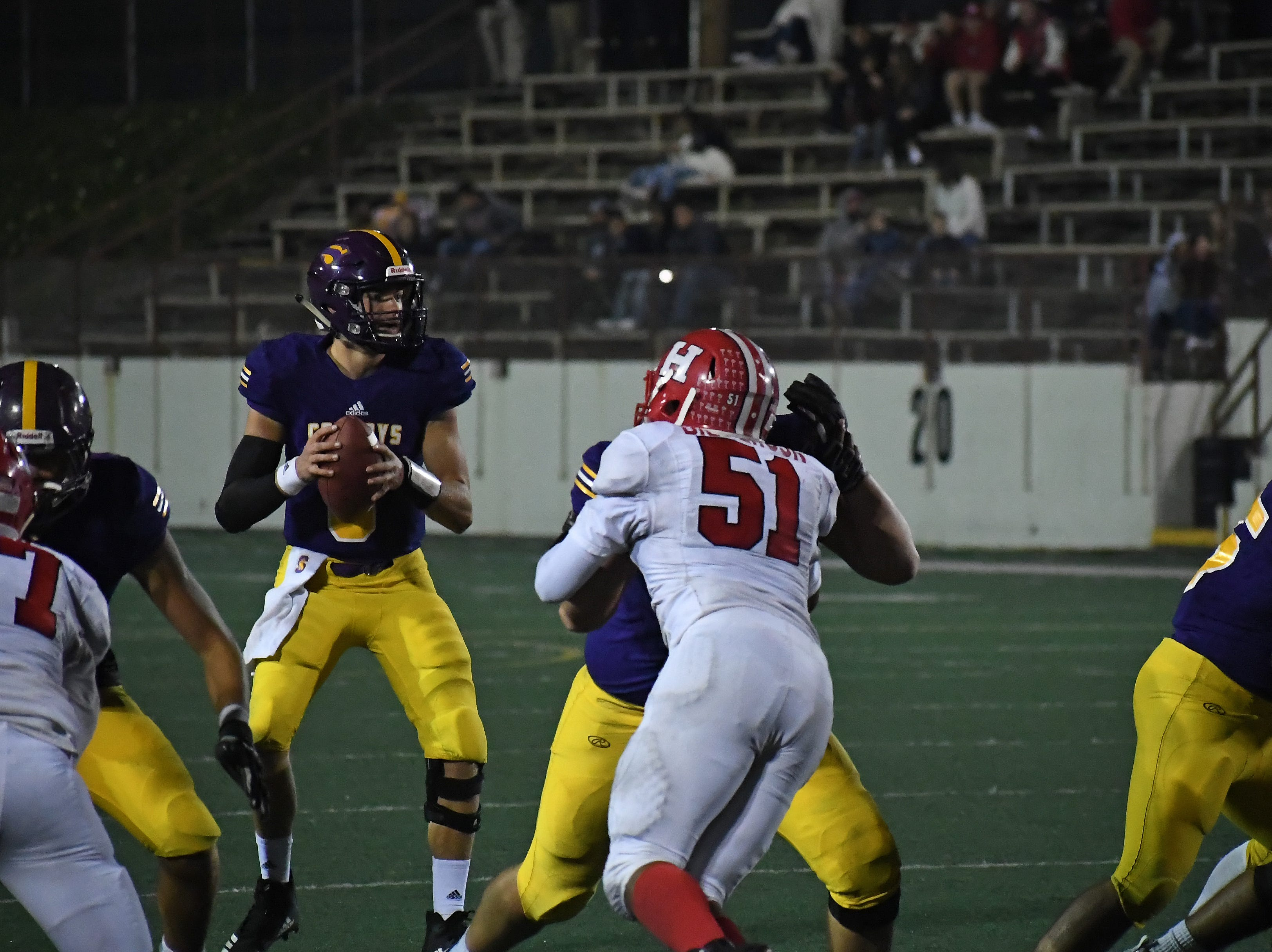 Quarterback Carl Richardson (8) looks left in the red zone.
