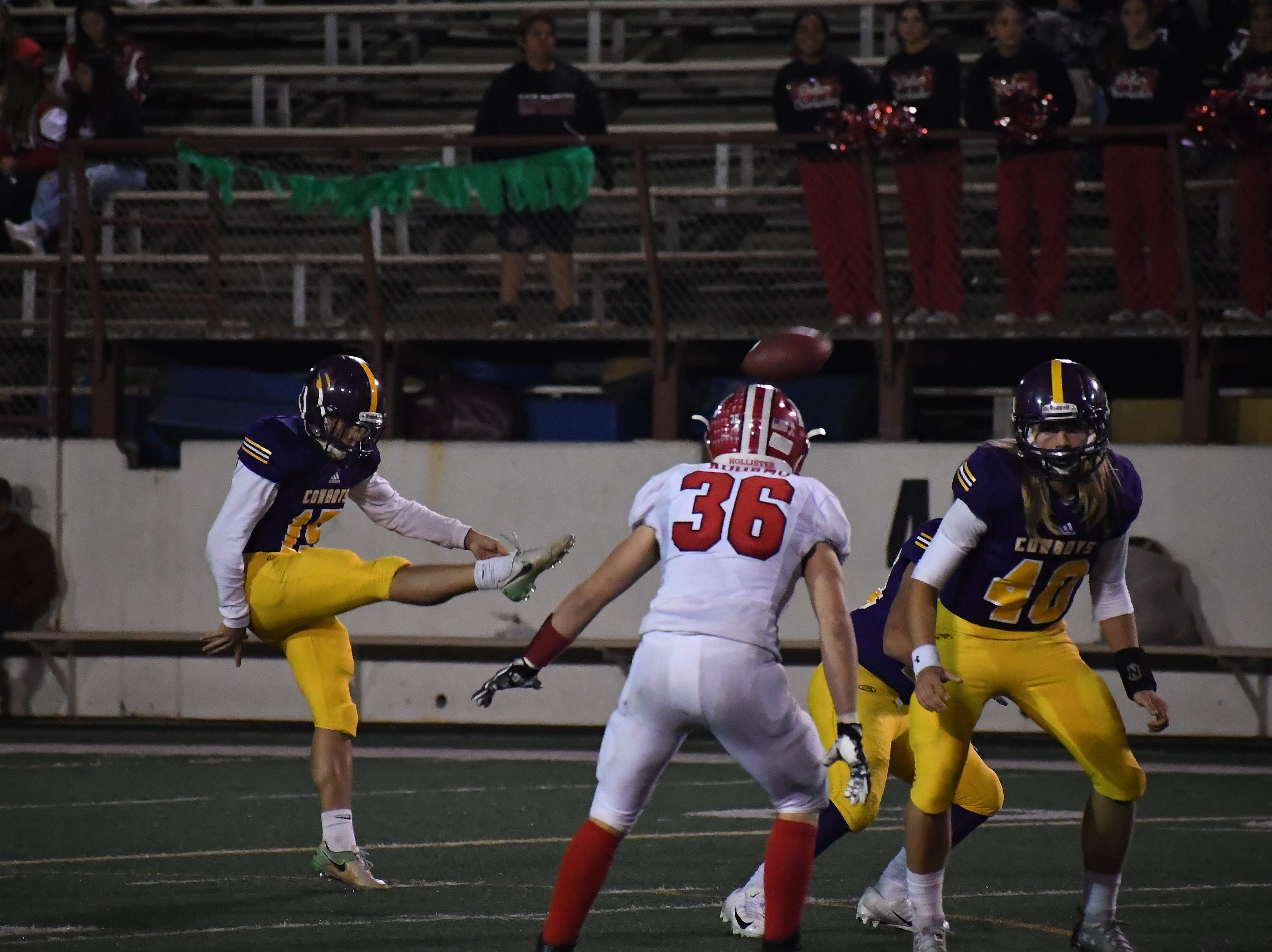 Punter Matthew Scott (15) boots his only punt of the night.