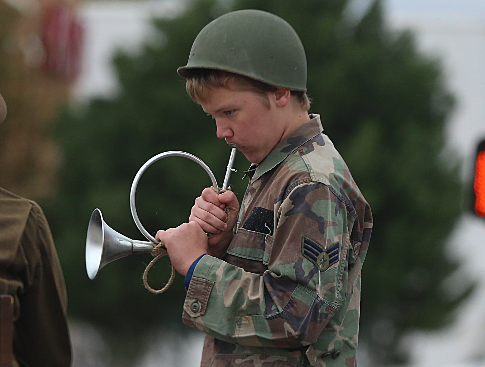"A student from Ambleside School of San Angelo pretends to play a horn Saturday, Nov. 10, 2018, during the 15th annual Veterans Day Parade, themed ""Honoring faithful freedom defenders."""