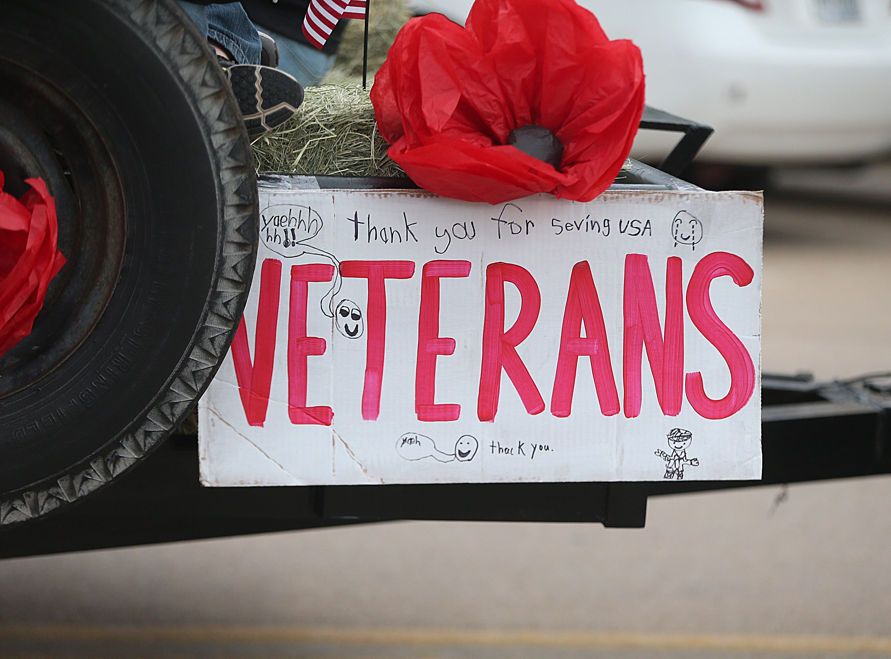"A thank you sign hangs on a float Saturday, Nov. 10, 2018, during the 15th annual Veterans Day Parade, themed ""Honoring faithful freedom defenders."""