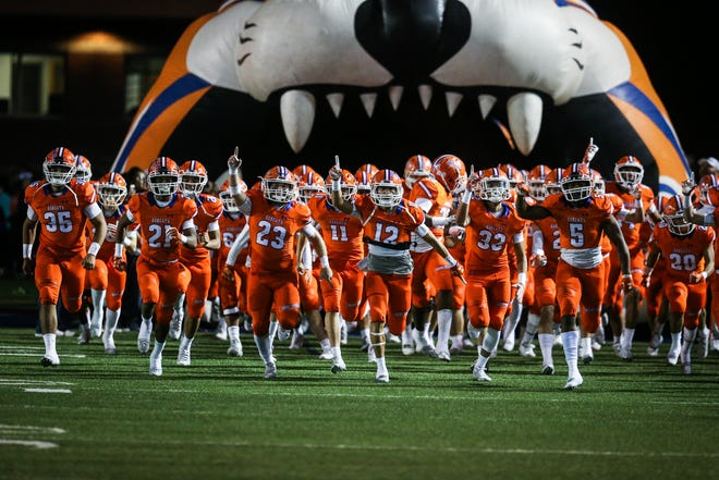 The San Angelo Central Bobcats take the field before their game against Fort Worth Haltom on Friday, Nov. 9, 2018, at San Angelo Stadium.