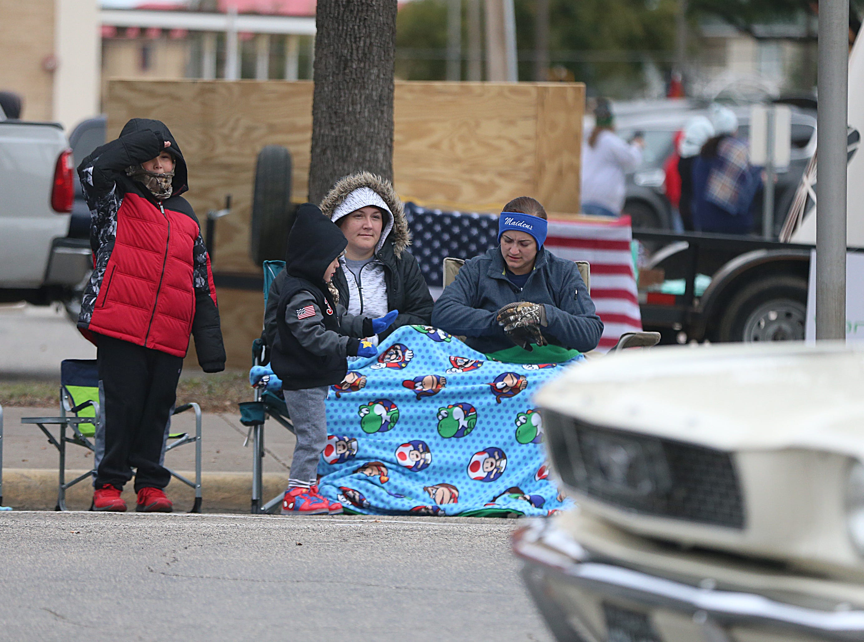 "A young boy salutes veterans Saturday, Nov. 10, 2018, during the 15th annual Veterans Day Parade, themed ""Honoring faithful freedom defenders."""