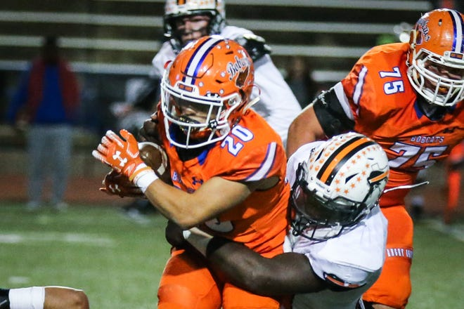 Central's Bobby Pena is tackled as he runs the ball against Haltom Friday, Nov. 9, 2018, at San Angelo Stadium.