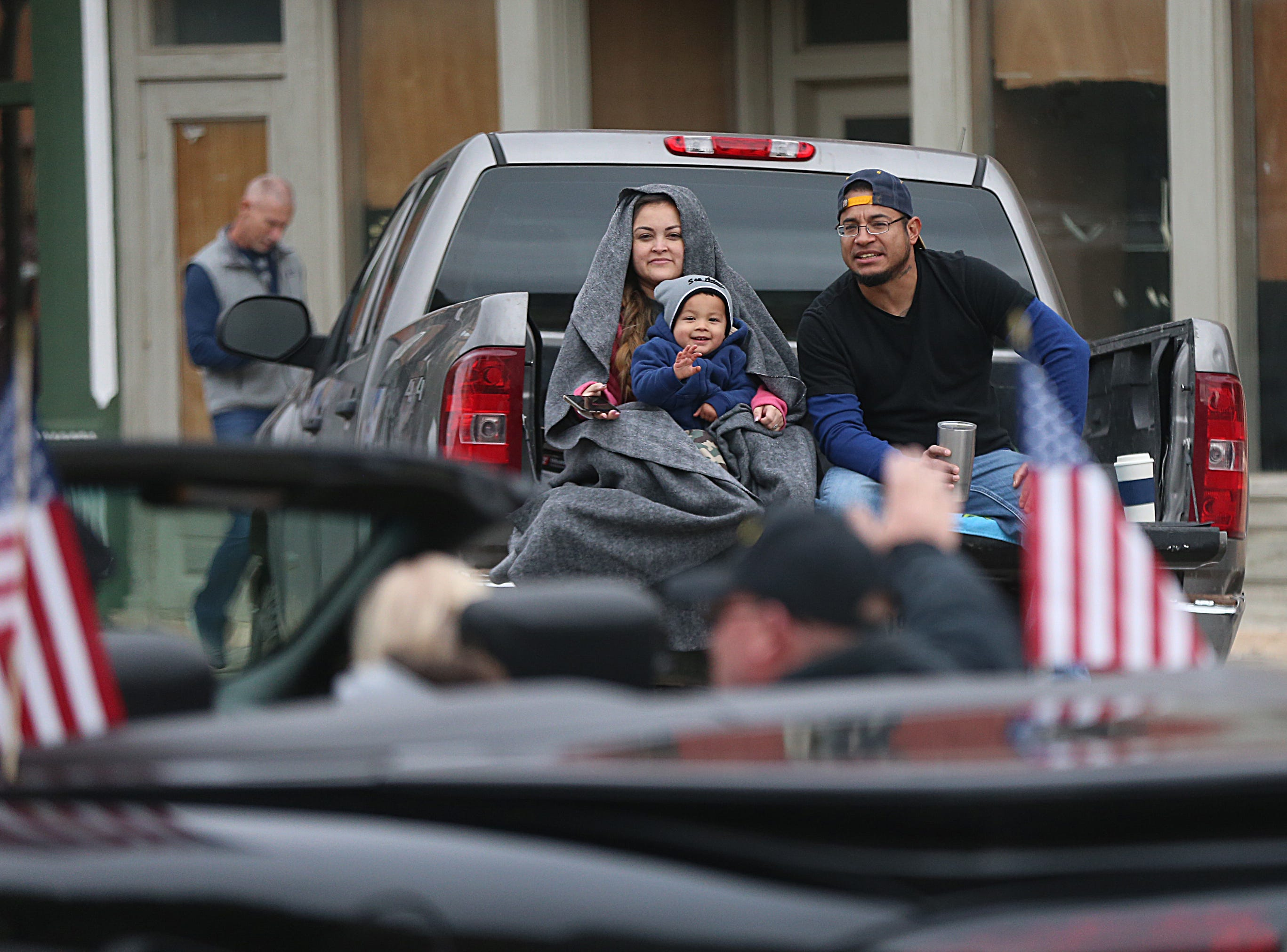 "Spectators wave to veterans Saturday, Nov. 10, 2018, during the 15th annual Veterans Day Parade, themed ""Honoring faithful freedom defenders."""