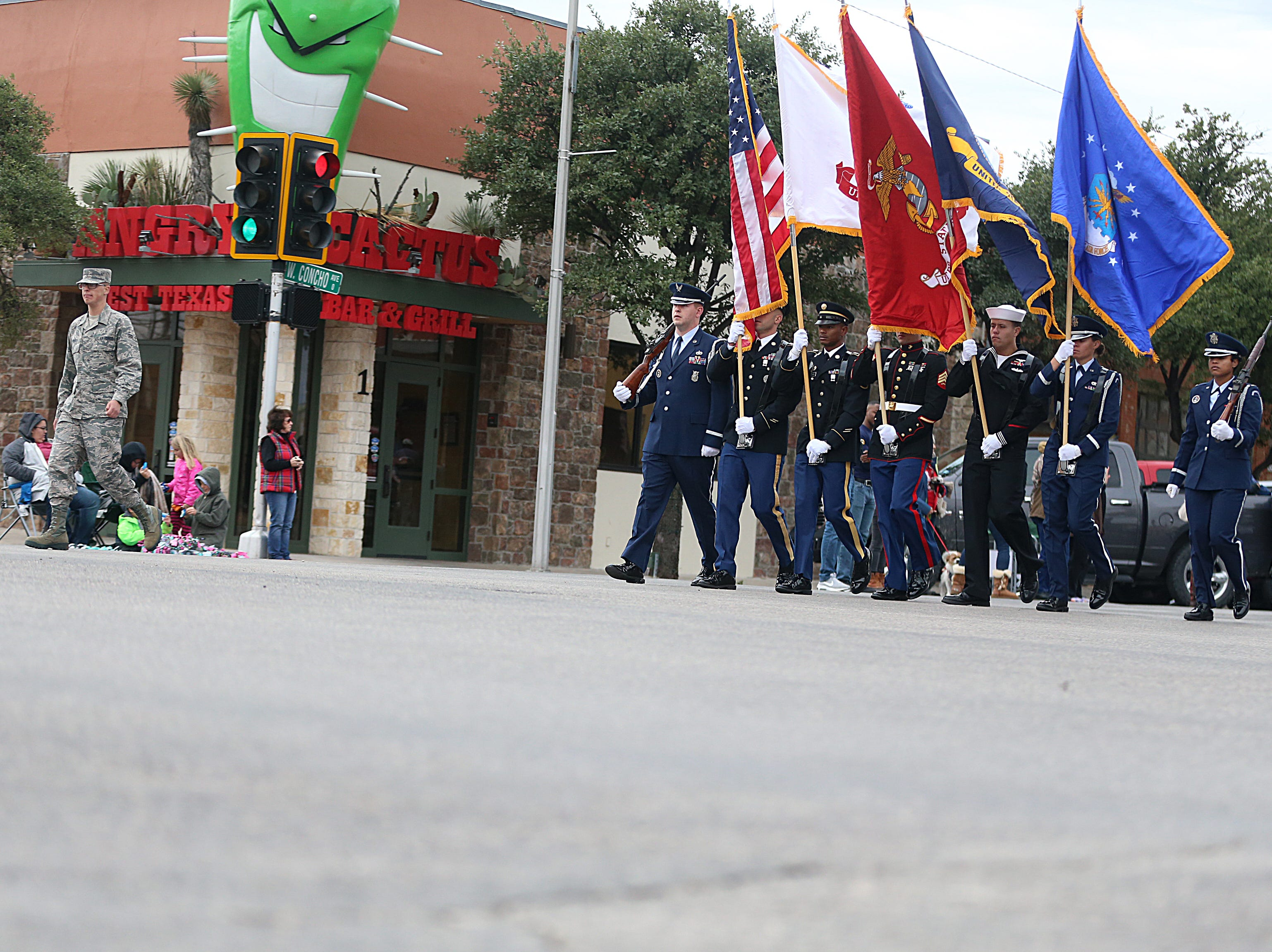 "Goodfellow Air Force Base's Joint Service Color Guard lead the parade Saturday, Nov. 10, 2018, during the 15th annual Veterans Day Parade, themed ""Honoring faithful freedom defenders."""