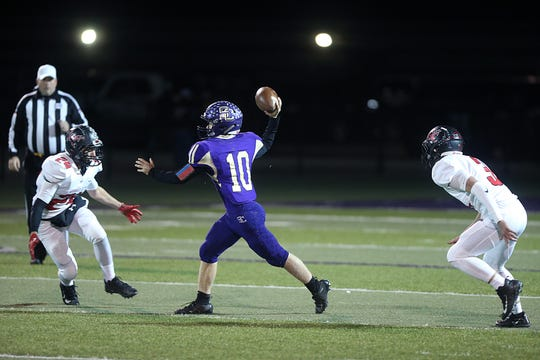 Sterling City's Wyatt Sisco (10) throws a pass while surrounded by Garden City's Raul Almazan (24) and Trae Jost (3) Friday, Nov. 9, 2018, during their game in Sterling City.
