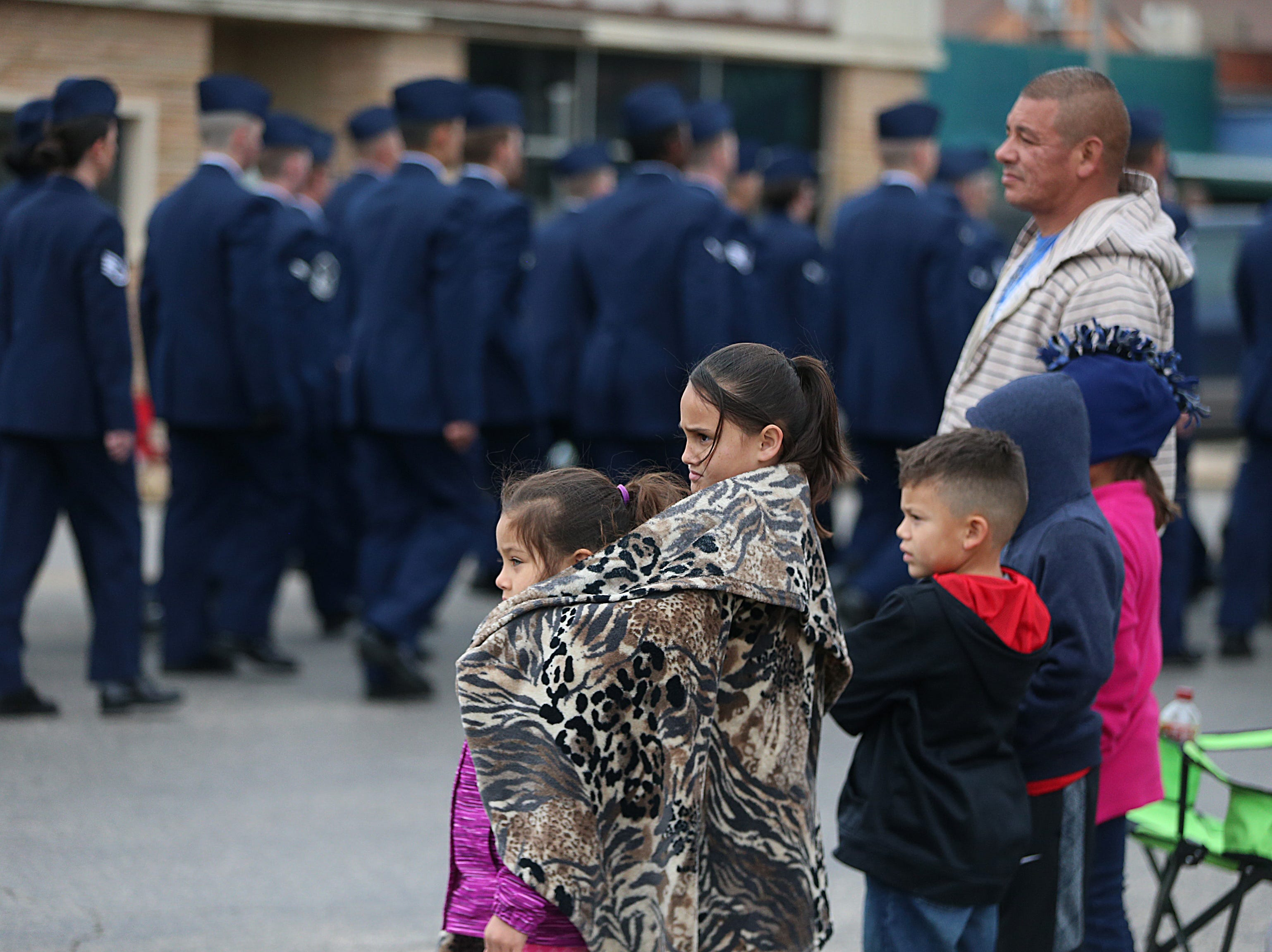 "Spectators watch as the Goodfellow Air Force Base service members march Saturday, Nov. 10, 2018, in the 15th annual Veterans Day Parade, themed ""Honoring faithful freedom defenders."""