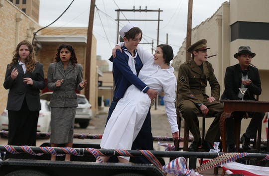 """Student's from Ambleside School of San Angelo recreate the iconicWWII kissing photo between a sailor and nurse Saturday, Nov. 10, 2018 during the 15th annual Veterans Day Parade, themed """"Honoring faithful freedom defenders."""""""