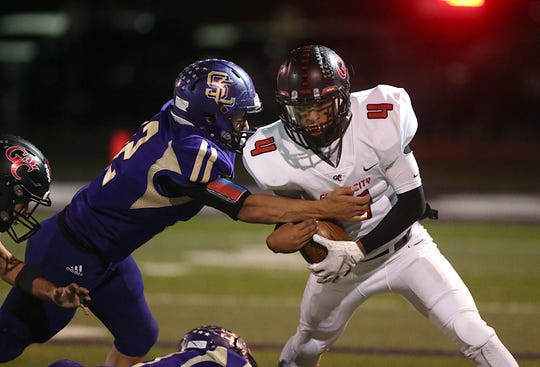 Garden City's Armando Alegria (#4) is tackled by Sterling City's Michael Gonzales (#12) Friday, Nov. 9, 2018 during their game in Sterling City.