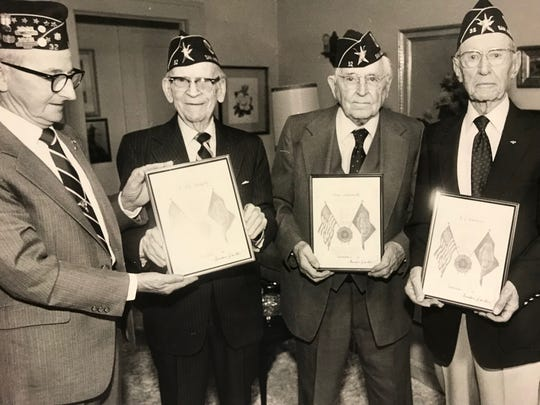 "Gordon Dalton stands with E.E. ""Pat"" Murphy, Dean Chenoweth and R. L. Baldwin, the latter three all founding members of the American Legion's James J. Goodfellow Post 32 in 1919, receive recognition for 65 years of membership in the organization in this 1984 file photo."