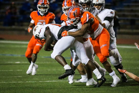 Central's Daylon Green tackles Haltom ball carrier Friday, Nov. 9, 2018, at San Angelo Stadium.