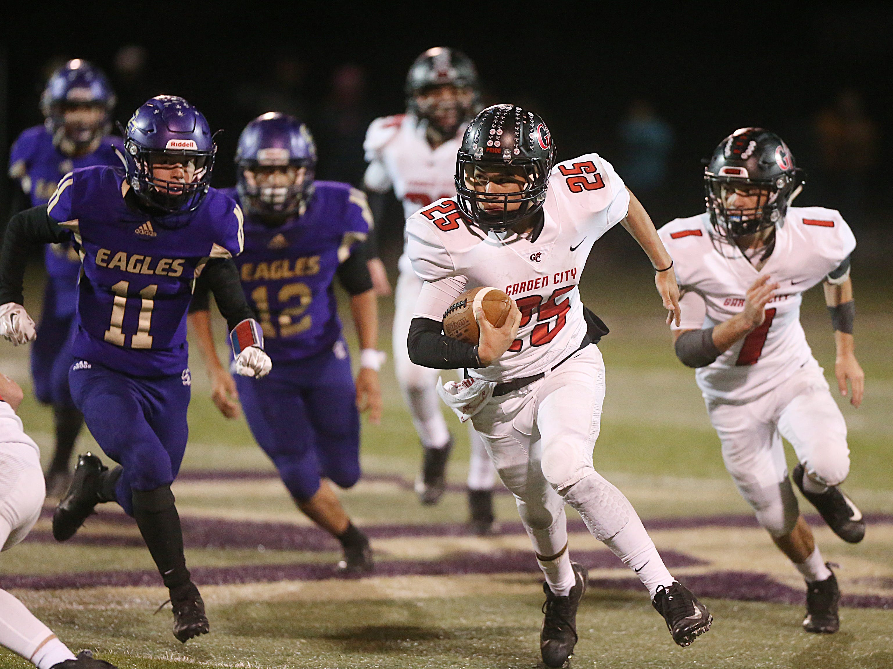 Garden City's Cesar Chavez (#25) rushes past Sterling City's defense Friday, Nov. 9, 2018 during their game in Sterling City.