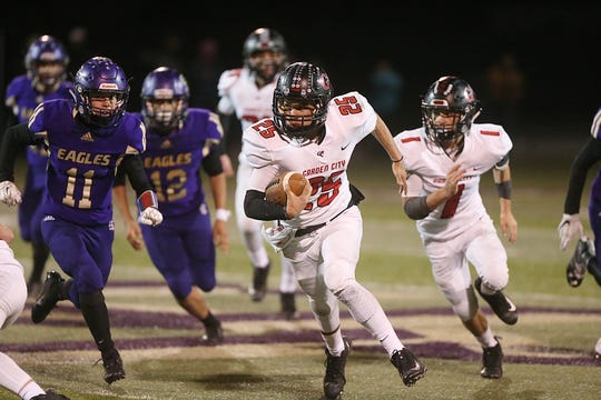 Garden City's Cesar Chavez (25) rushes past Sterling City's defense Friday, Nov. 9, 2018, during their game in Sterling City.