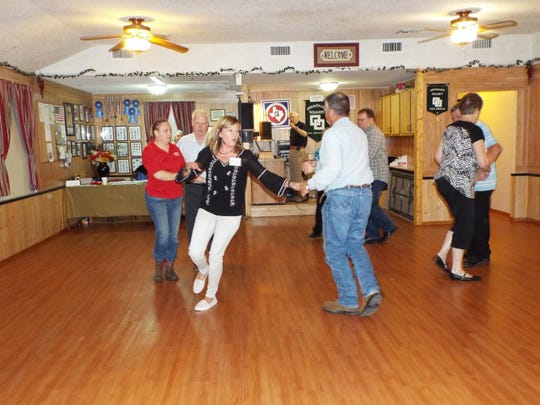 Square dance lessons are underway with Melinda Conklin and Jerrie Smithwick (at left) starting a right and left grand with Wes Thiers while other await their arrival.