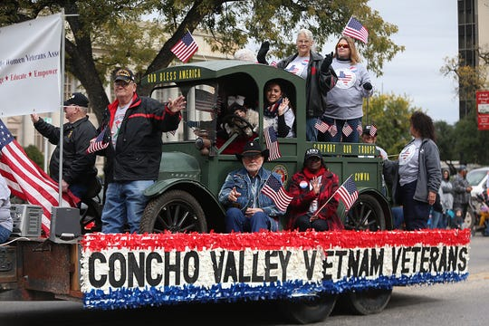 "Parade participants wave to spectators downtown Saturday, Nov. 10, 2018, during the 15th annual Veterans Day Parade, themed ""Honoring faithful freedom defenders."""