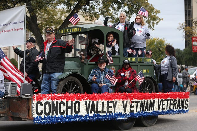 """Parade participants wave to spectators downtown Saturday, Nov. 10, 2018, during the 15th annual Veterans Day Parade, themed """"Honoring faithful freedom defenders."""""""