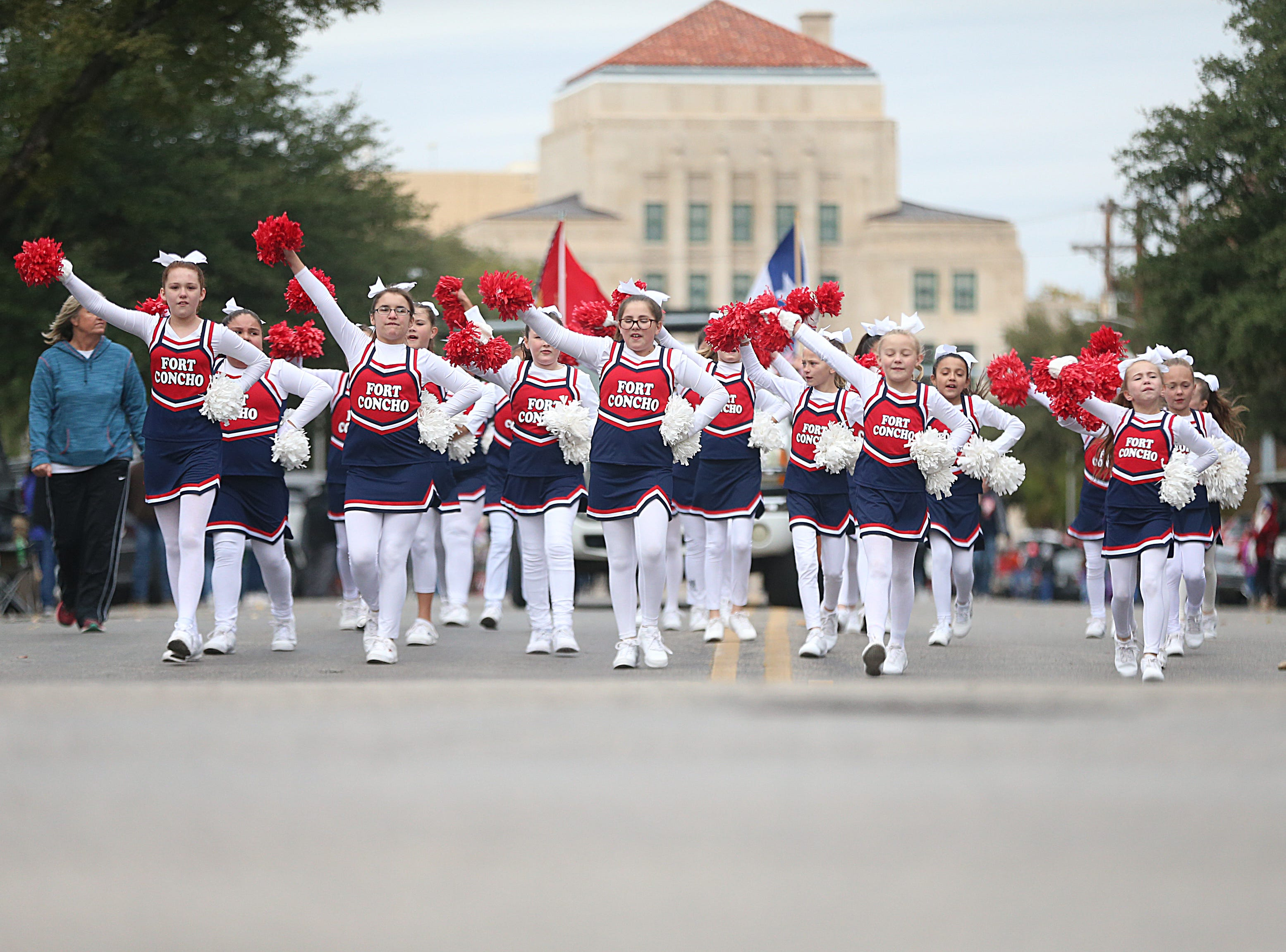 "Fort Concho Elementary cheerleaders march downtown Saturday, Nov. 10, 2018, during the 15th annual Veterans Day Parade, themed ""Honoring faithful freedom defenders."""