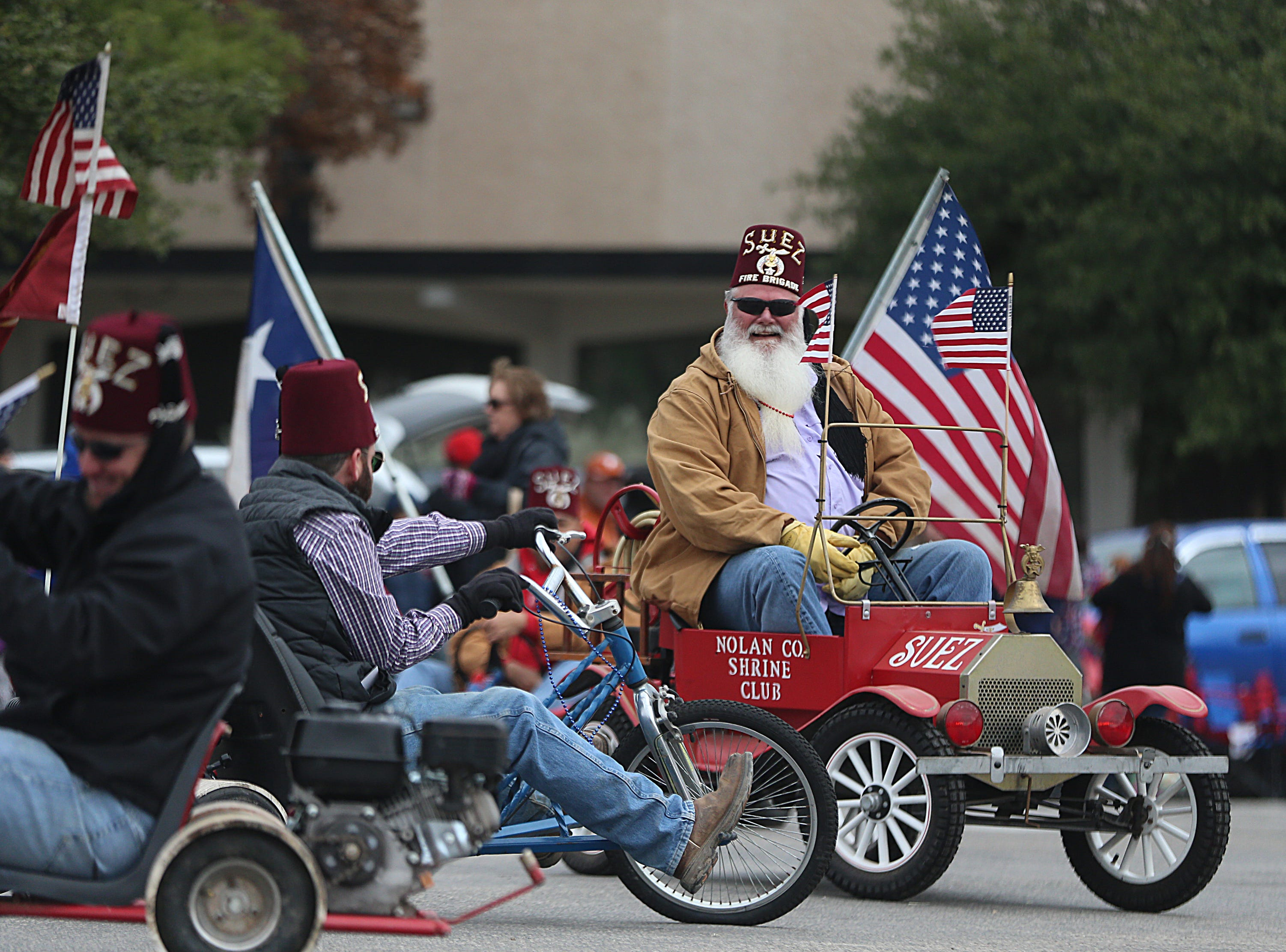 "Nolan County Shrine Club members ride around downtown Saturday, Nov. 10, 2018, during the 15th annual Veterans Day Parade, themed ""Honoring faithful freedom defenders."""