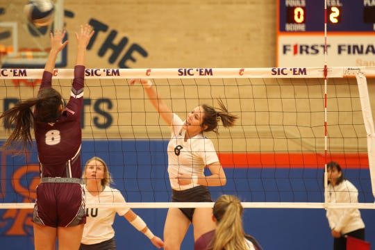 Water Valley's Cayce Jackson makes a kill attempt as Bronte's Karissa Cervenka goes up for a block during the Region I-1A volleyball finals at Central's Babe Didrikson Gym on Saturday, Nov. 10, 2018.