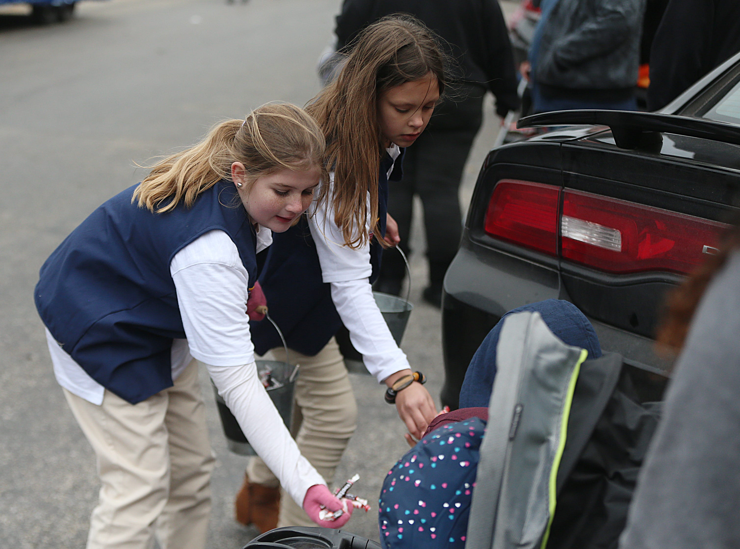 "Children pass out candy to other children downtown Saturday, Nov. 10, 2018, during the 15th annual Veterans Day Parade, themed ""Honoring faithful freedom defenders."""