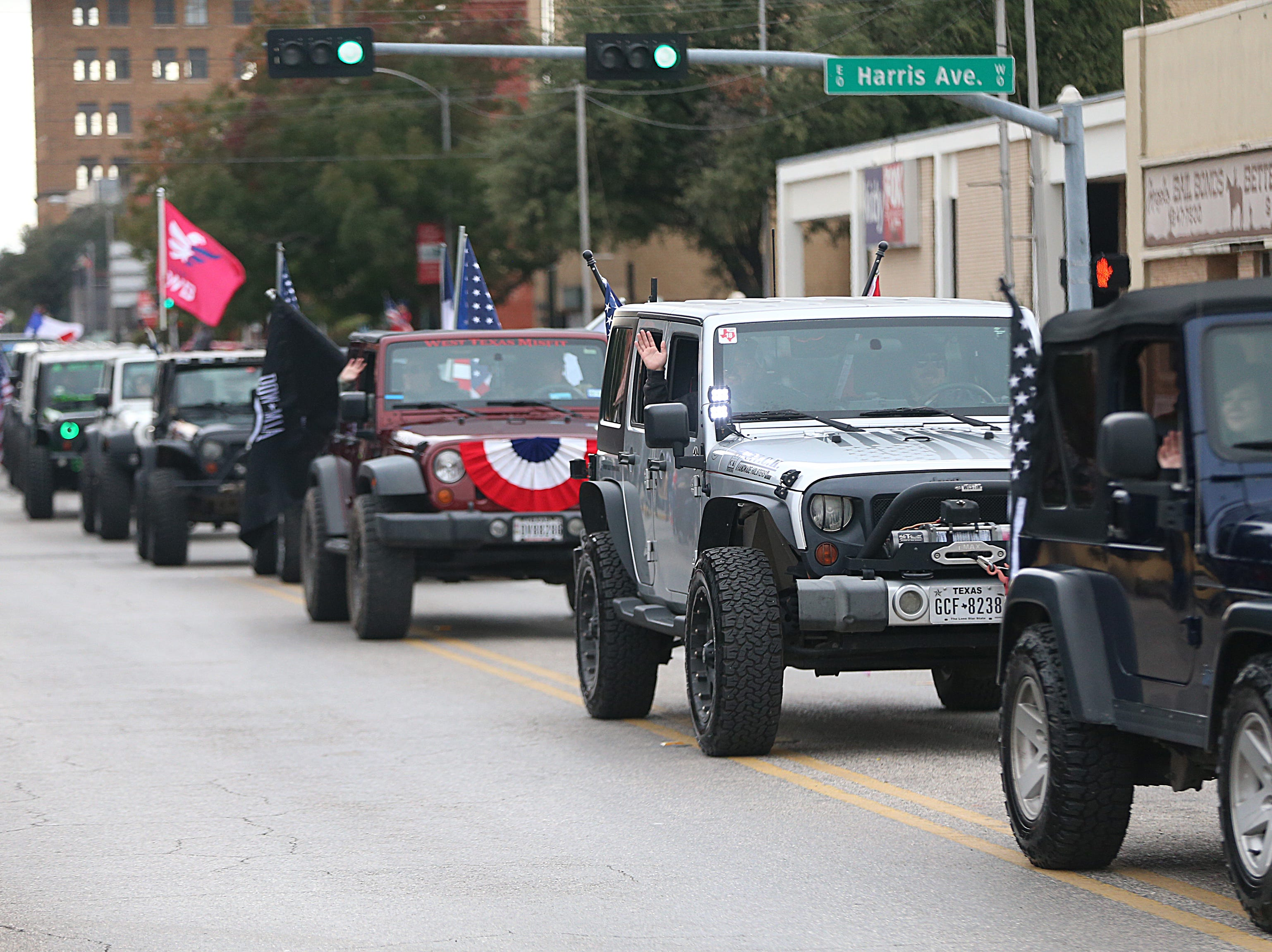 "Vehicles carrying veterans make their way downtown Saturday, Nov. 10, 2018, during the 15th annual Veterans Day Parade, themed ""Honoring faithful freedom defenders."""